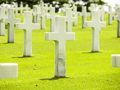 Crosses on the green lawn at the American Cemetery in the Philippines