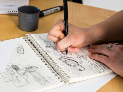A student sketching a design for an Industrial Design class
