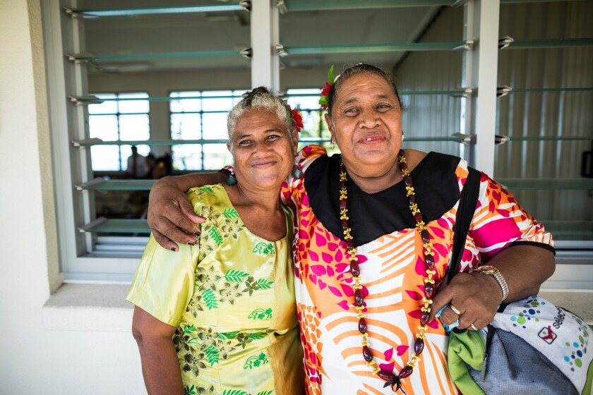 Two Samoan women pose for a photo.
