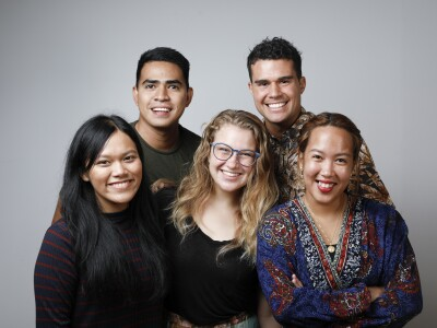 Image of multicultural students posing and smiling