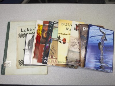 Publications of the Kula Manu lay on a table top.