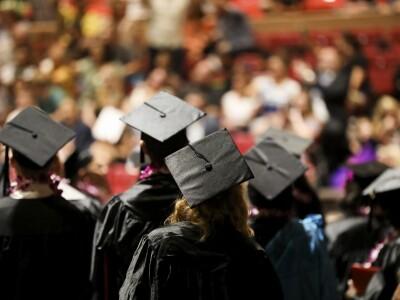 image of backs of Graduates at BYUH Graduation