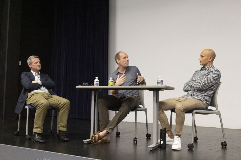 Three BYUH professors sit at a table in the Little Theater and discuss political polarization.