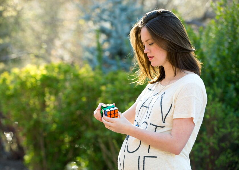 Katherine Decker playing with a Rubik's Cube during her 3rd trimester of pregnancy.