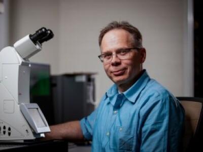 BYU chemistry professor with microscope