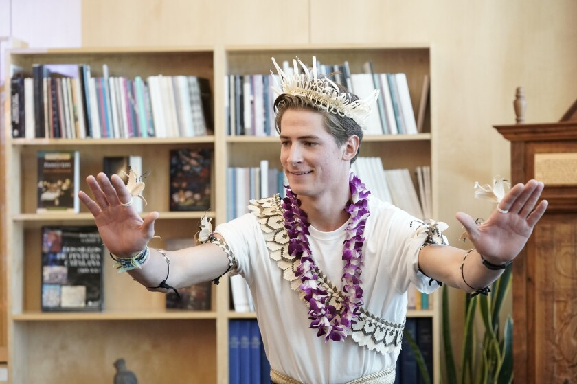 A BYU student performs a dance for the president of Kiribati.