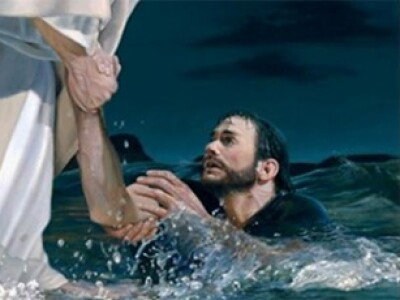 Jesus Christ pulls his disciple Peter out of the water