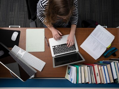 Image of a woman studying at a desk
