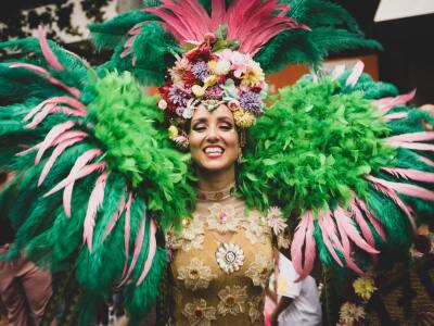 Mardi Gras Woman in costume with green feathers and headdress