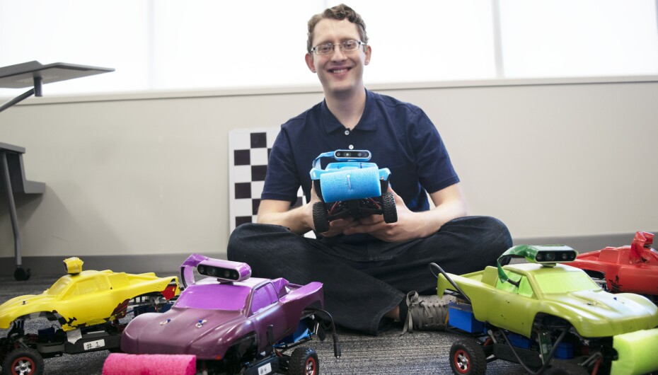 student with robotic cars