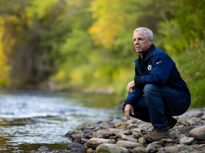 BYU professor Jim Nelson standing on the banks of the Provo River.
