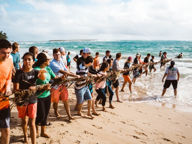 students performing the Hukilau at Hukilau beach