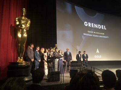 Kalee McCollaum and students accept the award for Grendel