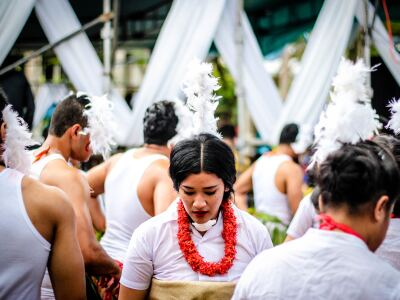A group of male and females wearing Tongan clothing