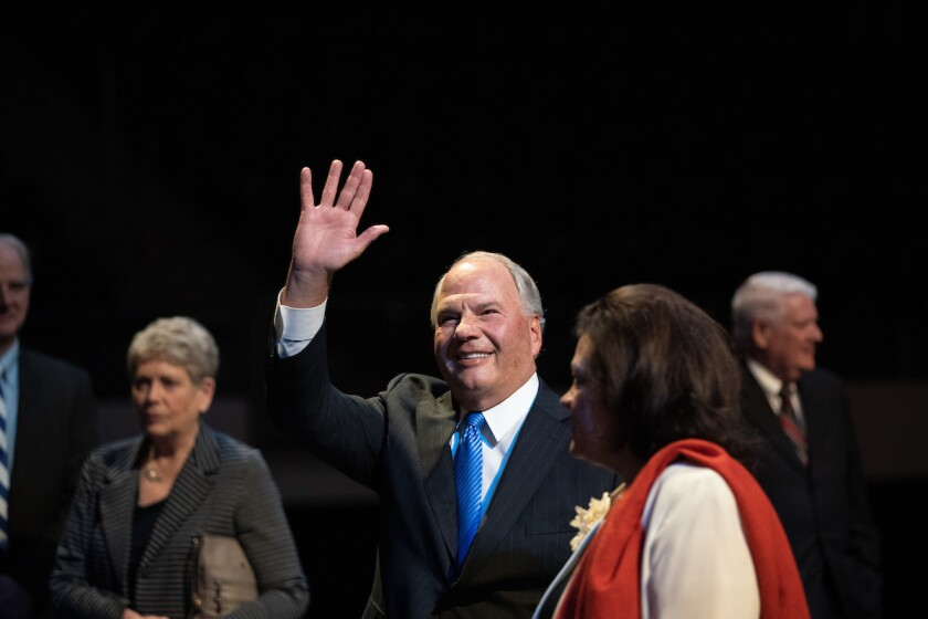 Elder Ronald A. Rasband waves to BYU Devotional attendees