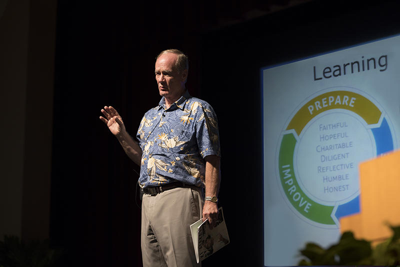 President Tanner stands center-stage and presents the revised Framework for Learning and Teaching on September 1, 2017. The circle flow-chart of the revised Framework in the background.
