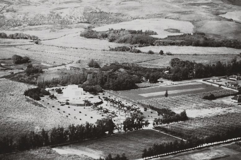 A black and white arial view of the Laie Hawaii Temple and its grounds and the surrounding town in the early 1930s-1940s.