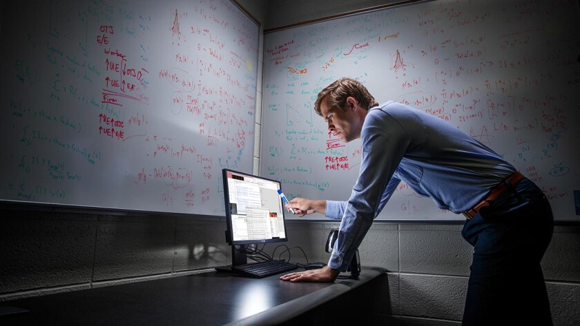 Student consults data on a computer screen