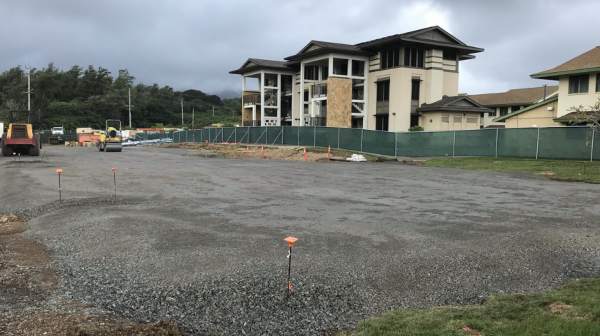 A view of the TVA Building D2 ground. Two heavy machines are preparing the ground for the slab. TVA X can be seen at the back of the construction site.