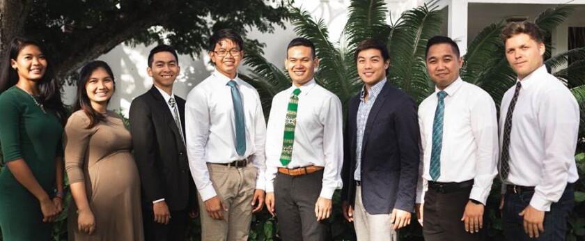 Enactus team smiling in church dress