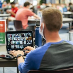 student attends class on Zoom while on campus