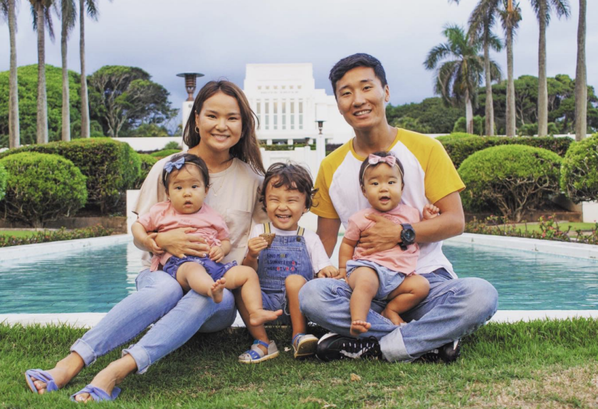 The Enkhbold Family sits in front of the Laie Hawaii Temple. They have 3 kids.