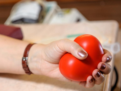 Image of a hand holding a red ball