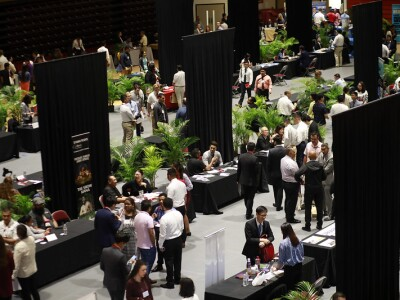 Students and employers meeting and talking at booths.