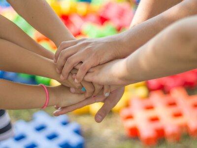 many hands holding together