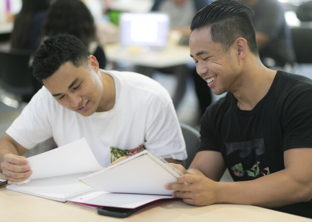 two male students having a group conversation
